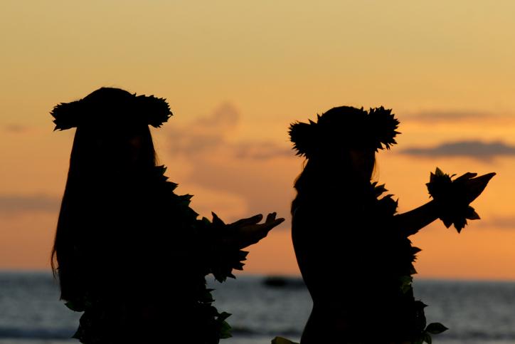 Girls dance the Hula during sunset